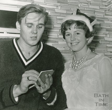Billy Fury singing an autograph at an unknown location, c.1964