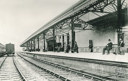 A Victorian lady and gentleman on the platform at Bath Spa Station, c.1900
