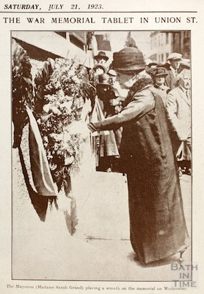 The Mayoress Sarah Grand placing a wreath on the War Memorial, Union Street, Bath, 1923