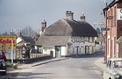 Thatched cottage on the Christchurch Road in Ringwood, Hampshire, c.1959