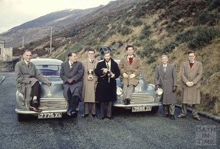 Seven photographers and two Morris Minors, Silent Valley Reservoir, Northern Ireland, c.1959