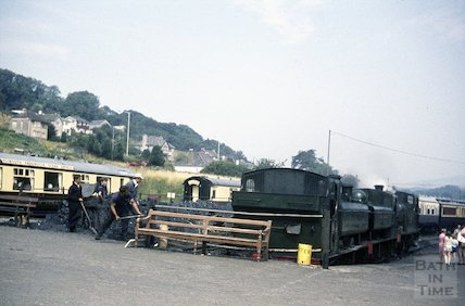 Volunteers shovelling coal for the awaiting steam train, possibly on the South Devon Railway, c.1960s