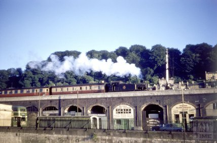 Steam train crossing the viaduct and railway arches in Bath, c.1959