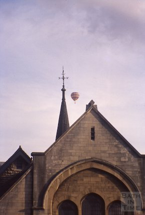 Exterior of Beechen Cliff Church with passing hot air balloon, c.1960s