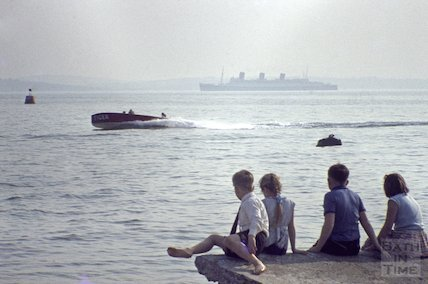 RMS Queen Mary sails past, watched by a group of children, c.1960s