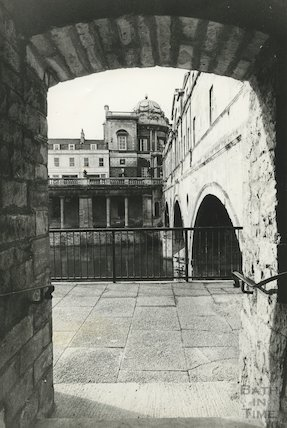 Looking out under the entrance to the terrace beside Pulteney Bridge, 7 February 1972