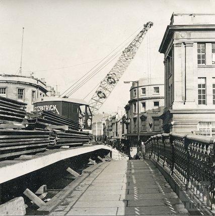 Contractor's crane preparing to demolish the Old Bridge, Bath, 1964
