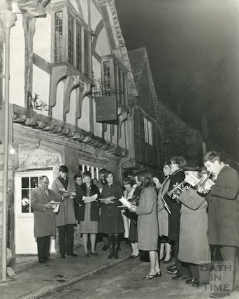 Carol singers outside The Sign of the Angel Guest House, Lacock, 1965