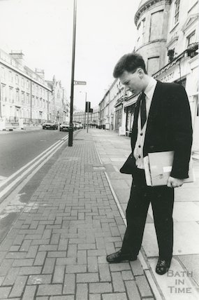 Christopher Woodward, Director of the Building of Bath Museum inspecting the pavement, 4 April 1992