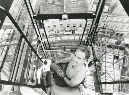 Tony Butcher operating a crane at the Sawclose construction site of the Seven Dials Centre, Bath 29th July 1991