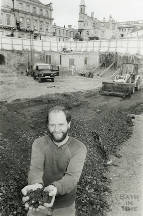 Mark Beaton (Bath Archaeological Trust) holding soil at the Seven Dials construction site, Sawclose, Bath 5th September 1990