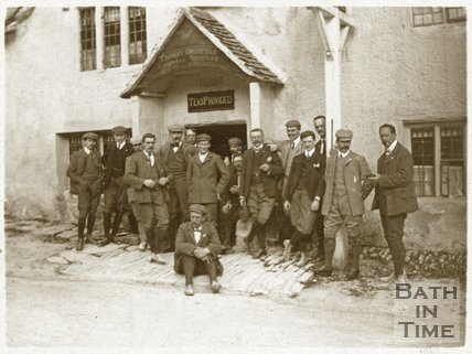George Love Dafnis and friends outside the White Hart, Castle Combe, c.1895