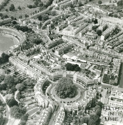 1957 Aerial view of the Circus, Bath and buildings to the north, July