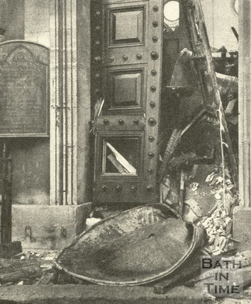 The bomb damaged entrance to St James Church, Bath, April 1942