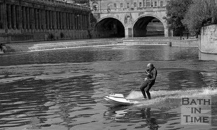 Motorised surfboard at Pulteney Weir, Bath, 26 July 1975