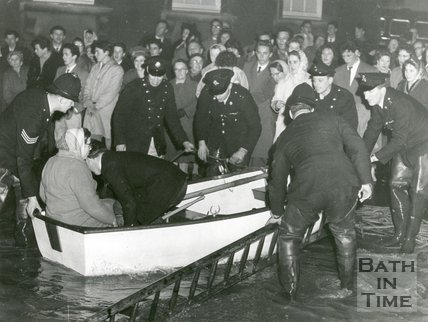 The police rescuing a lady in a rowing boat during the Bath Floods, 1960