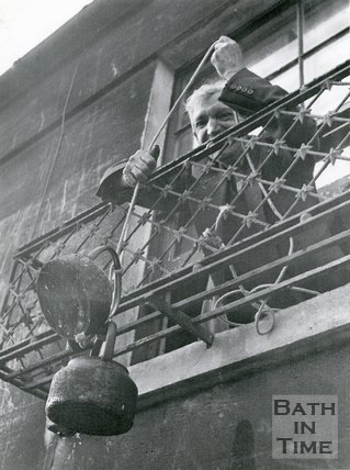 Hoisting up a kettle for water supplies during the Bath Floods, 1960