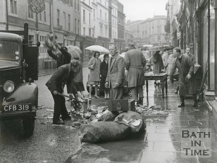 Clearing flood damaged goods on Southgate Street, Bath, 1960