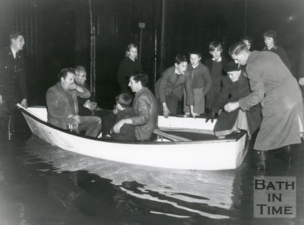 Rescuing a family by rowing boat from the floods in Bath of 1960