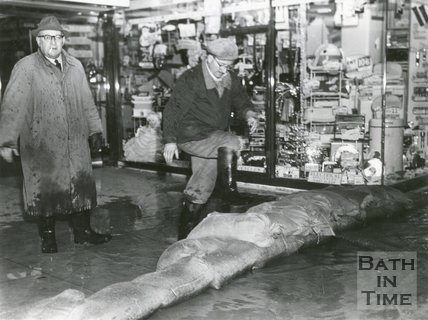 A row of sandbags trying to protect a shop in Southgate Street from the floods in Bath of 1960