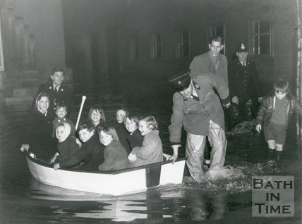 Excited children being evacuated by boat during the Bath Floods of 1960
