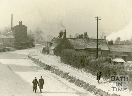 Men walking on the frozen Kennet and Avon Canal by the George Inn, Bathampton c.1930