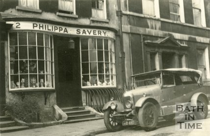 An elegant car outside Philipa Savery antique shop, 2, Abbey Street, Bath c.1945