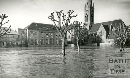 View across the flooded River Avon towards St. John's Church from Ferry Lane, Bath 1960