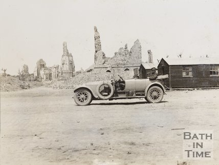 Ruins in Bailleul, France with officers car in foreground