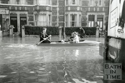Keith Rippin taking marooned residents along Pulteney Road to Caroline Buildings during the Bath Flood, December 1960