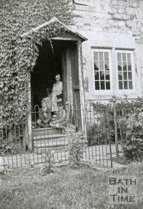 A family group outside Charlcombe Farm House, Charlcombe, near Bath, 1948