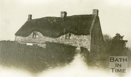 Old thatched cottage, Newton St. Loe c.1900