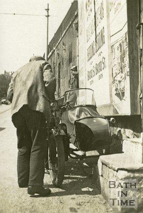 A motorcycle sidecar combination on London Road below Walcot Parade, Bath c.1920