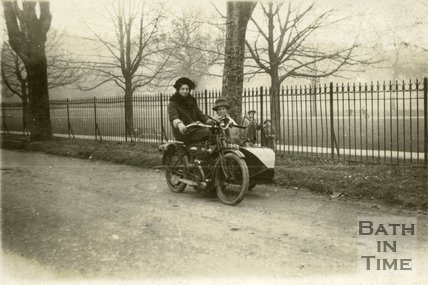 Two ladies pose with a motorcycle sidecar combination, possibly beside Henrietta Park?, Bath c.1930