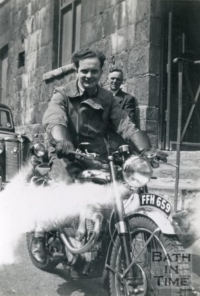 A man on his 350cc BSA ZB32 Trials motorcycle below Walcot Parade, Bath c.1949