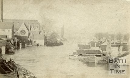 The River Avon and Dolemeads looking towards St. John's Church, Bath during the floods, possibly 1866 or 1867