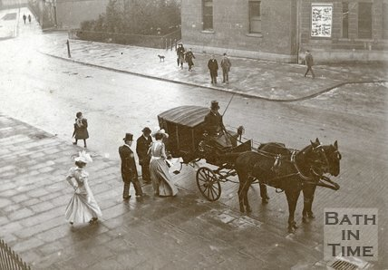 An elegant group of people prepare to get into a horse drawn coach opposite Green Park Station, Bath c.1900