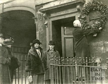 Mr. T. S. Cotterell placing a wreath on Dickens' Plaque in Bath, 1922