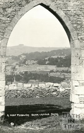A peep through Sham Castle towards Camden Crescent, Bath, c.1920.