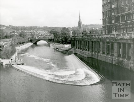 View of the newly constructed Pulteney Weir, Grand Parade and flood defence scheme, Bath, 1972