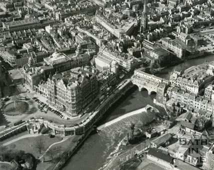 1960 Aerial view of the old weir at Pulteney Bridge, Empire Hotel and Guildhall, Bath
