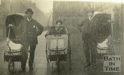 Three gentlemen with Bath Chairs outside Edgar Buildings, George Street, Bath, c.1910