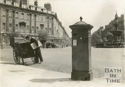 A postman delivering a parcel at Laura Place, Bath, c.1930s