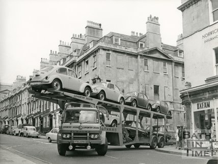 A car transporter turning into Gay Street from George Street, Bath, c.1970