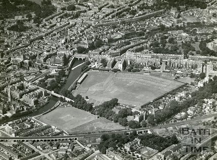 1935 Aerial view of Bath looking over the Dolemeads and the Recreation Ground towards Pulteney Bridge, July