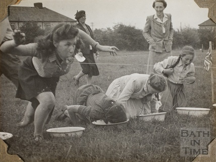 Girls apple bobbing, Charlton Park, Keynsham 1945