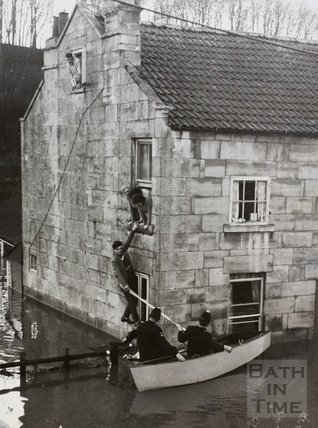 Police rescuing flood trapped residents, 1, Yewmead Cottages, Brassmill Lane, Bath 1960
