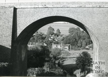 A view looking east under the Midford Viaduct on the Somerset & Dorset Joint Line showing the Cam Brook near Midford, c.1960