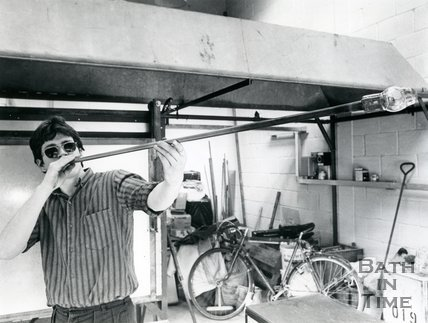 Neil Wilkin of Wilkin and Woodmen, Bath, blowing glass, 1985