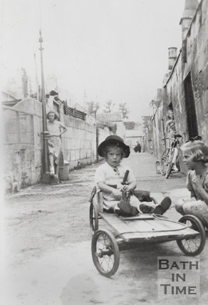 Children playing in a back alley to the rear of Dafford Street, Larkhall, Bath, 1952